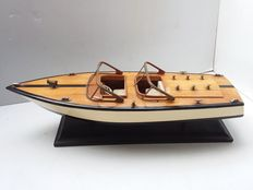 Wooden speed boat.