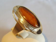 Handmade amber ring with opaque amber, around 1930
