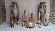 Collection of 12 copper vases, jugs from india