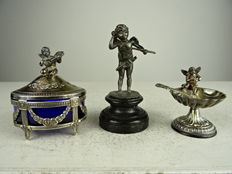 Two silver salt cellars and a silver plated cherub
