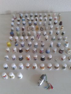 Collection of 105 thimbles and a complete travel sewing kit