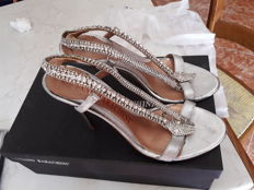 Sandals with rhinestone covered snake-like straps by Luciano Barachini