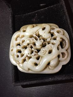 Jade pendant carving of dragons