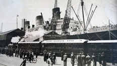 11 vintage press photographs of the building and the maiden voyage of the RMS Queen Mary ca. 1935