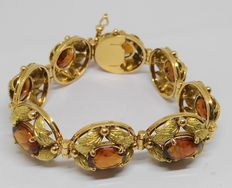 Large 18 kt gold bracelet with brown oval cut quartz – Total of 32.1g.
