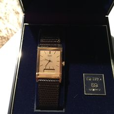VINTAGE SEIKO QUARTZ MEN/WOMEN'S GOLD plated WATCH WITH BROWN LEATHER BAND