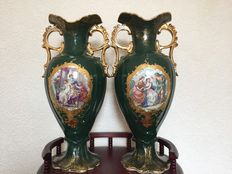 pair of gilt twin handle green vases .