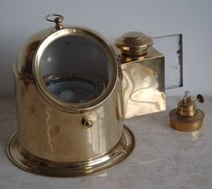 Dome shape compass with oil fired boiler