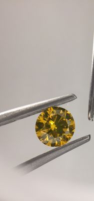 0.41 carat fancy vivid yellow round shape diamond. Clarity - VS2