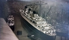 9 vintage press photographs of the building and the maiden voyage of the RMS Queen Mary - ca 1935