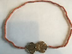 Precious coral necklace with a 14 karat gold bible lock.