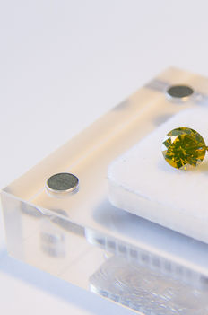 0.54 carat fancy vivid yellow round shape diamond. Clarity - VS2