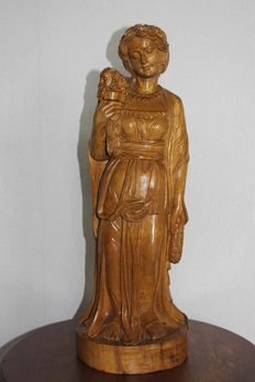Wooden hand-carved statue of Greek Goddess