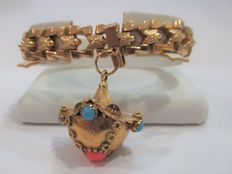 Gold bracelet with elaborate charm