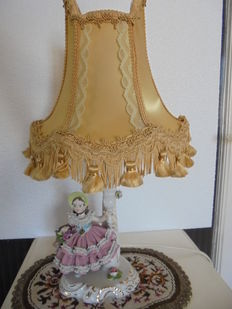 Porcelain lamp with a flower girl