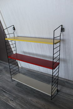 A. Dekker for Tomado – 'Pocket' bookshelf/wall rack in the authentic colours.