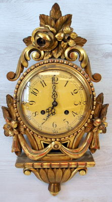 Westerstrand Toreboda Swedish wood carved gold plated Cartel clock in Louis Seize style.  1st part 20th century