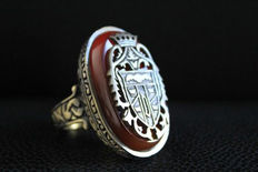 Majestic copper signet ring of high quality with a piece of natural carnelian