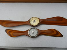 Wooden propellors with barometer.