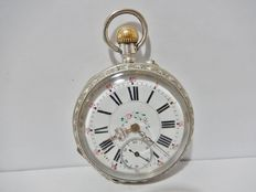 Antique pocket watch in silver, early 20th century with metal-worked casing and chiselled movement.