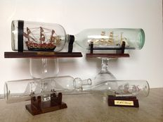 Beautiful llot of 4 boats in bottle