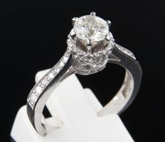 White gold 14 kt ring set with a central Bolshevik cut diamond and entourage of octagon cut diamonds, ring size 17.5 (55).