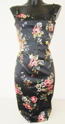 Dolce & Gabbana, black dress with a floral pattern.