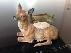 Viennese figurine of a deer lying down - approx. 1900-1930