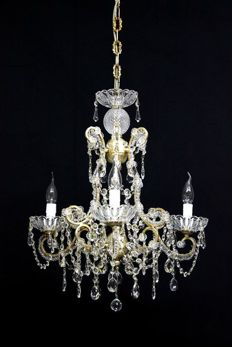 Replica of a Maria-Theresa style 4-light metal chandelier with antique gold decorations - Italy - new