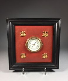 Barometer in black wooden frame with gilded ornaments in Empire style