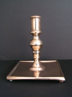 "A bronze candlestick on four low legs, about 1690 ""Spanish-Dutch"""