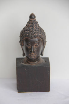 Buddha head on wooden pedestal- Thailand - end of the 20th  century