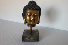 Wooden Buddha's head on a golden plinth - China - End of 20th century.
