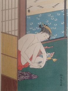 Woodcut in soft colours of an exposed woman who grooms herself by Suzuki Harunobu (1724-70) (reprint) - Japan - approx. 1920