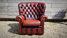 A leather Chesterfield style High Back Chair, England, late 20th century
