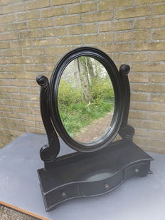 A black vanity mirror after an old model