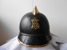 Leather fire helmet with brass emblem and edges and comb