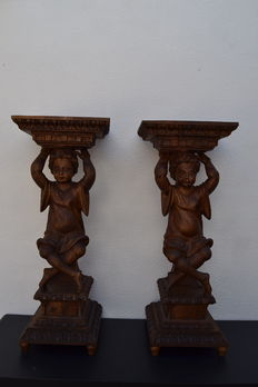 Large pair of wooden columns carved as seated boys - Portugal ca. 1940