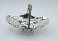 A silver sweetmeat basket with flower cast handle, Italy, 21st century