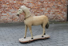 Antique toy horse - carved wood and horse skin, France, early 20th century
