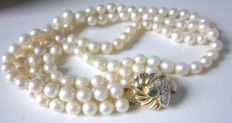 2-rowed cultured Akoya pearl necklace, clasp with emerald and diamonds made of 585 yellow gold!