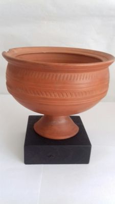 Roman terra sigillata cup with decoration - height 125 mm
