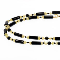 Necklace in 18 kt yellow gold with onyx and citrine. Length: 86 cm.