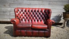 A leather Chesterfield style High Back 2-seater Sofa, England, late 20th century