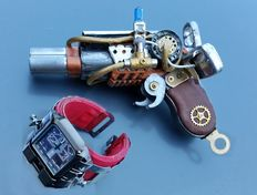 Art of recycling ,handmade steampunk objects : weapon and  Bracelet Watch,