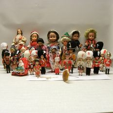 31 Very old traditional costume dolls of which 2 pincushions