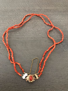Red coral necklace with gold clasp.