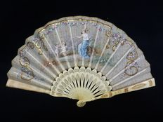 A carved bone and hand painted organza folding fan - Spain or France - second half 19th century