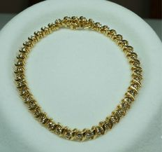 Gold bracelet with 3.52 ct VS / H diamonds.