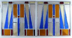 A set of geometric Art Deco stained-glass windows